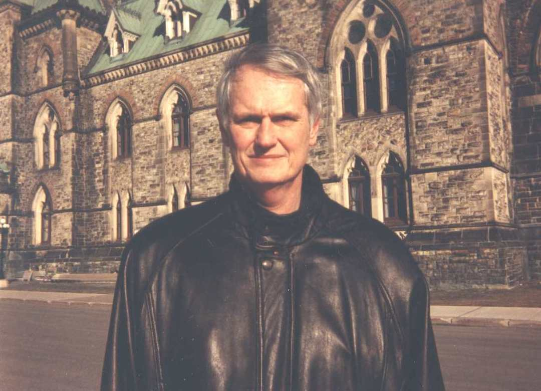 Patrick Grady standing in front of East Block